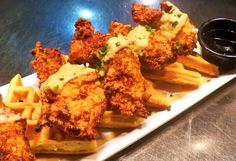 Took me a bit to understand this dish, then I had it.  YUMMY!  Beautiful presentation of a southern tradition.  Fried chicken and waffles!