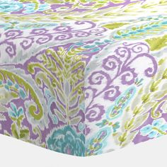 """Aqua and Purple Jasmine Crib Sheet by Carousel Designs. Our fitted crib sheets feature deep pockets and have elastic all the way around the edges to hug mattresses securely. Fits standard crib mattresses, measuring approximately 28"""" x 52""""."""