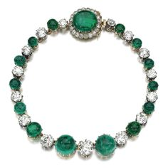 Impressive emerald and diamond necklace Composed of a line of cabochon emeralds alternating with cushion-shaped and circular-cut diamonds, the clasp highlighted with a cabochon emerald framed with circular-cut diamonds, length approximately 385mm, detaches into twenty-five motifs.