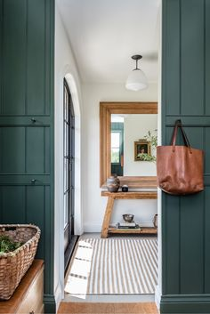 Angela Wheeler Design - Mudroom with dark green panelled walls, loads. - Angela Wheeler Design – Mudroom with dark green panelled walls, loads of hooks le - Dark Paint Colors, Interior Paint Colors, Interior Design, Interior Ideas, Entryway Console Table, Entryway Decor, Entry Foyer, Leather Bench Seat, Style Me Pretty Living
