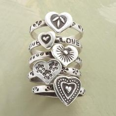 """Five hearts, each unique, represent the many forms of love. One band is engraved all around with LOVE. Brushed sterling silver. Exclusive. Set of 5. Whole sizes 5 to 9. 1/2"""" together."""
