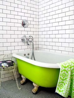 White subway tile, green claw foot tub