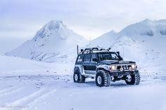 """A very decent Y60 Nissan Patrol on 44"""" tyres with a snorkel and automatic tyre inflation system which allows you to regulate tyre pressure from the driver seat, even while moving."""