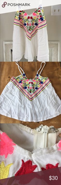 Top with Colorful Embroidered Detail This top brings color to any outfit! Perfect for a summer day or vacation. The top does have a little rip at the collar, small enough where I have worn it without people noticing! The top is a size 8 but fits like a Small! Debbie Dabbie Tops Tank Tops