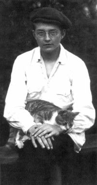 "According to the back of the Naxos CD on which this appears, this picture of Dmitri Shostakovich was taken ""two days before the completion of the First Symphony, 28th June, 1925."" That is, before Stalin's terrors began. Ah, Mitya. It is good to see you reasonably happy. And I love your cat."