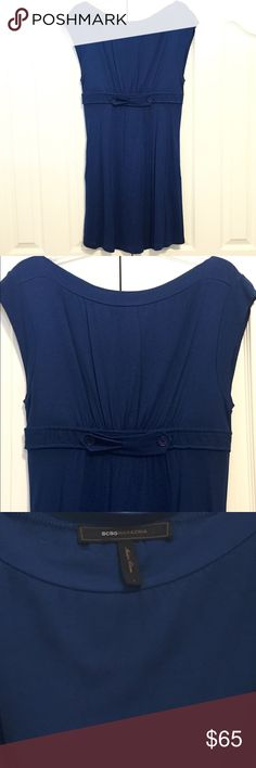 BCBGMAXAZRIA Dress BCBGMAXAZRIA Blue cocktail dress, short sleeve, crossover bow detail, two side pockets, perfect for weddings, a night out, or any occasion. Only worn twice. Soft light material. BCBGMaxAzria Dresses Midi