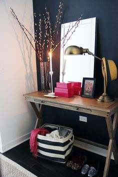 Chic styled foyer with navy blue paint color accent wall (love World Market Campaign Console Table, West Elm Mirror-Framed Wall Mirror, The Container Store Rugby Stripe Bin, Ikea Blomster Candle Holders, hot pink lacquer boxes and brass lamp. Decoration Inspiration, Interior Inspiration, Decor Ideas, Mirror Inspiration, Interior Ideas, Style At Home, Small Foyers, Navy Walls, Sweet Home