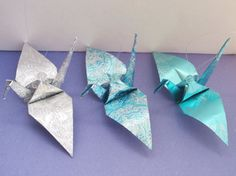 These large crane ornaments are hand-crafted from approximately 6 x 6 of silver and turquoise tone papers. The finished cranes are approximately 5~6