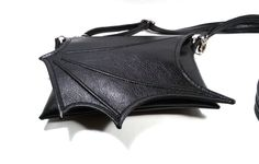 Black bat wing bag, Black Faux leather bat wing bag, Black leatherette bat bag, crossbody bag, messenger bag, vegan bag  Unusual bag - made of high-quality artificial leather that looks like real leather. Bat wing bag is for those who like different and unusual things. Original design  Handmade  inside:viscose lining adjustable strap: 2.5 cm 1 inch  bag size: 21 x 15 cm 8.2 x 5,9 inches  Velcro is the only way to close flap without ruining the design of bags due to the specific way of…