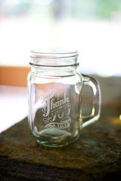 Custom etched mason jars as favors- LOVE!! photographed by http://www.liveviewstudios.com, via http://theeverylastdetail.com/a-rustic-lavender-north-carolina-wedding/