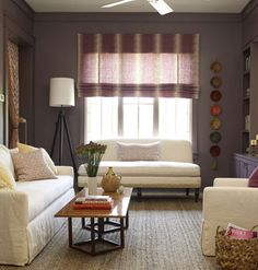 Two large sliding doors separate the den from the rest of the house, and can easily become an extension of the living room, or a private space for reading or napping. A natural fiber rug and an ikat window shade add interest and texture to the room.   Tak