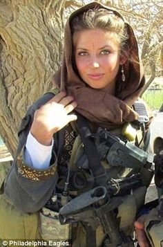 Kurd woman posing. Innocent civilians are being murdered on a daily basis. Do you think of this reality as you pose for the camera? War is not glamorous.