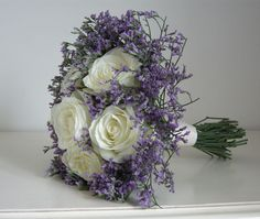 Avalanche roses with lilac limonium
