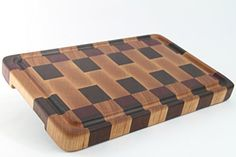 "This stunning piece of functional art includes beautifully handcrafted Walnut, Purpleheart and Cherry woods. This beautiful board is constructed in the ""end grain"" butcher block style, which provides an extremely durable surface which will not dull your knives too quickly! This cutting... see more details at https://bestselleroutlets.com/home-kitchen/kitchen-dining/cutlery-knife-accessories/cutting-boards/product-review-for-handcrafted-wood-cutting-board-end-grain-c"