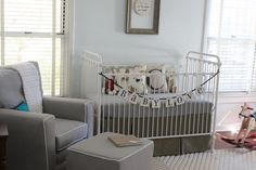 like this nursery. love the wall color sherman williams tinted blue