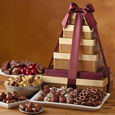 Enjoy a variety of chocolates in this delicious chocolate tower. Includes chocolate cherries, dark chocolate Moose Munch Popcorn, chocolate malt balls, a pound of Harry & David's signature chocolate truffles and more.