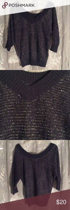 Blue sparkly Express sweater Navy blue sweater with silver sparkles. Great condition! XS but would be very loose. Would definitely fit S or M too. Express Sweaters V-Necks