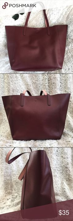 Vegan Leather Large Tote REVERSIBLE burgundy pink Measures approx 22x14x7 inches reversible vegan pebbled leather. Color is burgundy and reverses to a rose pink. New with tags. Urban Outfitters Bags Totes