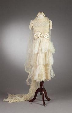 CREAM SILK SATIN AND TULLE WEDDING DRESS AND VEIL. 1920.