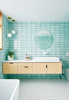 Mint bathroom with plywood vanity, circular mirror and pendant lamps. Mint tiles contrast beautifully with white tiles on the floor. Bathroom Interior, Mint Bathroom, Interior, Beautiful Bathrooms, House Colors, Grey Bathrooms, Bathroom Interior Design, Pallet Patio Furniture, Bathroom Design