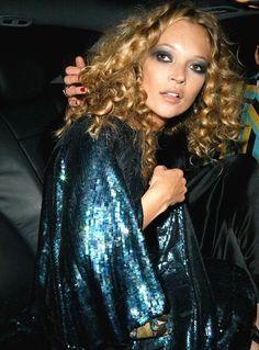 Kate Moss wearing vintage aquamarine sequin dress and golden ringlets.