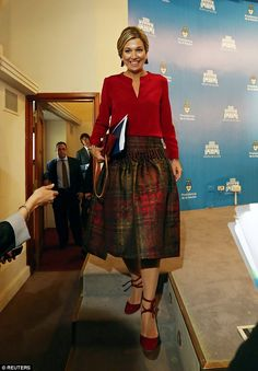 Queen Maxima of the Netherlands made an unusual fashion choice this afternoon as she was seen sporting tartan to a news conference in Buenos Aires