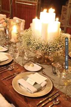 Cake stand with candles and baby's breath.   VIA #WEDDINGPINS.NET