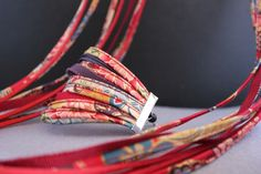 Crea-Nais fabric jewelry, as seen in Arles, France