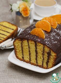 Предлагаю угоститься ароматнейшим кексом с апельсиновой цедрой и щедро сдобренным шоколадом. Это очень вкусный, слегка влажный кекс, особенно хорош на 2-3 день, так как шоколад предохраняет кекс от высыхания и способствует его быстрейшему созреванию. За рецепт благодарю от души MAKL-Марина, она ссылается на источник: кулинарный журнал за 1995 год. Мной внесены незначительные изменения.