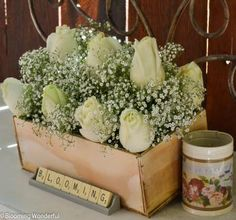 baby's breath and roses in vintage crates