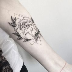 The Black and white, well distinct floral tattoo for girls. This tattoo is drawn up with some geometric dotted lines, giving this tattoo as unique appearance.