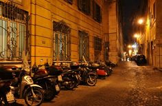 This looks like via S.Anna. I used to get on a motorino almost every night parked near here. I loved riding through the streets at night. Near Largo Argentina – photo by globalgadabout