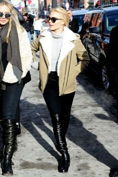 How Celebs Look Amazing Even When It's Freezing #refinery29  http://www.refinery29.com/sundance-red-carpet-pictures#slide-9  Margot Robbie stays extra toasty by slipping into a pair of sexy, thigh-high boots — essentially an extra pair of pants.