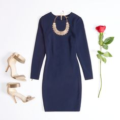 This navy bodycon dress features a stunning jacquard knit and chic gold zip details.
