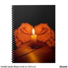 Candle, hands, flame, wood. spiral note book