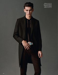 Thibaud Charon dons a long tailored coat and slim-cut trousers from Tiger of Sweden.