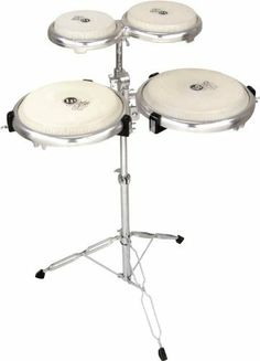 """LP Compact Conga Bongo Set by LP. $637.00. Combines Latin Percussion's Giovanni Compact Congas with Compact Bongos, producing full sounds even while dispensing with shells. The set includes a conga stand and mounting system for the congas and mounting post for the bongos.Giovanni Compact Congas with Stand This uniquely designed, shallow, portable pair of congas was the winner of a 2003 MiPA award. It includes two conga sizes: 11"""" and 11-3/4"""". Constructed with a speci..."""