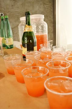 Mimosas in the Morning: Strawberry Lemonade Mimosa. Made in a punch bowl for easy self-serve. Includes lemonade, lemon, puréed strawberries, frozen raspberry lemonade concentrate and champagne.