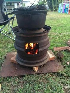 Repurposing at its best. Tire wells to fire pit and cooker.