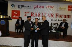 """Honourable Chief Guest, Mr. Sohail Lashari, President, Lahore Chamber of Commerce & Industry (LCCI) awarding the souvenir to Mr. Shahid Mehmood, ConnecTel as Sponsor Partner on """"2nd RAKIZAR Forum"""" on """"Innovation & Growth-Retail Industry"""" held on Wednesday, January 8, 2014 — at Royal Palm Golf and Country Club  Event's Detail: https://www.facebook.com/events/235896246566146/"""