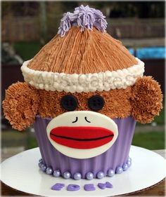 Sock Monkey Giant Cupcake super easy spin on the sock monkey, giant cupcake style. Inspired by another cake design. I added button eyes and. Monkey Cupcake Cake, Monkey Smash Cakes, Sock Monkey Cupcakes, Sock Monkey Party, Big Cupcake, Giant Cupcake Cakes, Mini Cakes, Cupcake Ideas, Cake Smash