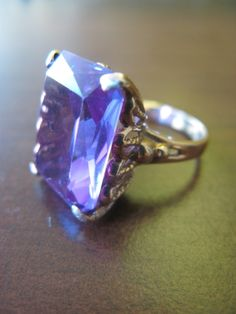 Alexandrite, my birthstone.  I want this ring.