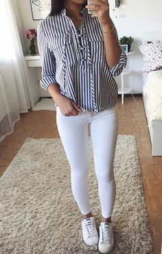 Striped shirt, white jeans, and sneakers.