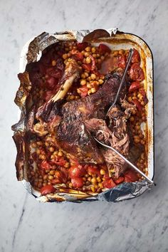 Turbo boost your family Sunday dinner with Jamie Oliver's slow cooked Moroccan Lamb shoulder. This recipe for Tender Lamb Shoulder is a classics quick and easy recipe where you bung it in a baking tray and let the oven do the work. Quick to prepare and slow roasted in the oven for 6 hours, this is a phenomenal sharing feast that feeds 6 to 10 people. Enjoy this melt in the mouth lamb served with tomato & preserved lemon chickpeas with no fuss but all the flavour of a classic Moroccan dinner.