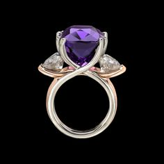 Poised and vibrant. Allegre Ring features interlacing curves of white and rose gold, with a sumptuous amethyst and two rose zircons. Call us at (949) 715-0953 or click below for additional information.