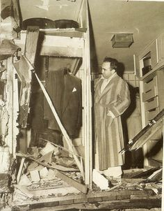 Mickey Cohen observes the affects of a bombing plot to kill him in his brentwood home. February 1950.