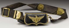 A Very Rare Civil War Union Army Staff Officer's Silk and Leather Belt and Cartridge Box. The heavy patent leather cartridge box is trimmed in thick brass and boasts a Federal eagle on the front made of heavy brass with some gilt present.