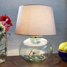 This lamp base has several unique features: made from recycled glass, it is fitted with a multi coloured cotton braided flex and a cork stopper at the top for the bulb holder. Recommended lamp shade sizes are and Glass Lamp Base, Table Lamp Base, Lamp Bases, Table Lamps, Hurricane Lamps, Hotel Decor, Luxury Decor, Recycled Glass, Glass Table