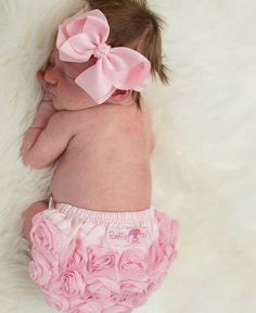 Precious Pink Satin Rosette Bloomer made by Ruffle Butts perfect for newborn pictures! Get it now at Lemon Pearl Boutique!