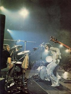 Phil Collins and Peter Gabriel, Genesis in concert.